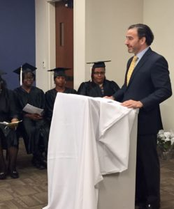 Board Chair Aaron Danzig speaks at the most recent CDA class graduation.